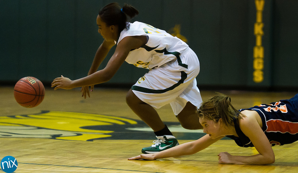 Central Cabarrus' Nekaya Thompson and Carson's Allison Blackwell fight for a loose ball Monday night at Central Cabarrus High School. Carson won the game 65-43. (Photo by James Nix)