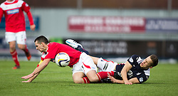 Falkirk's Will Vaulks gets hurt in the challenge from Brechin City's Craig Molloy. <br /> Falkirk 2 v 1 Brechin City, Scottish Cup fifth round game played today at The Falkirk Stadium.
