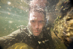 Ashley Cowie in the waters at from the Chia-Aig Waterfalls and Witches Pool..©Michael Schofield..