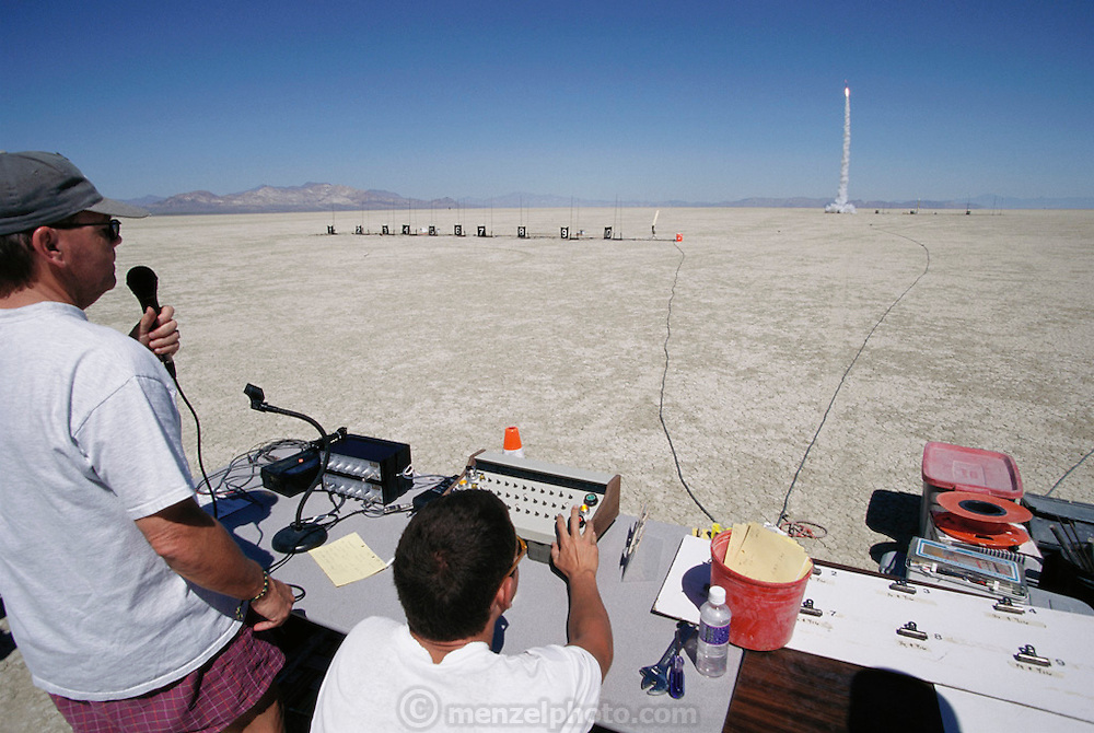 Amateur rocket launch. Amateur rocketeers remotely launching a rocket during the annual Black Rock X amateur rocketry event in the Black Rock desert, Nevada, USA. This huge flat expanse of land is a popular launch site for large and powerful amateur rockets as it is far from civilization and has little natural animal or plant life.