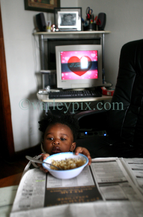 09 July 2006. New Orleans. Louisiana. <br /> Finding Faith. <br /> Faith Figueroa. A day in the life of. Faith reaches for her lunch, a bowl of rice. <br /> Following a ten month search for the little girl whose face appeared on the Sept 19th, 2005 cover of Newsweek magazine, Faith's mother, Miriam Figueroa has returned to town with her three children. Faith, (1 yrs), Anfernya (5yrs) and Jacquelyn (13 yrs). <br /> Credit; Charlie Varley/varleypix.com