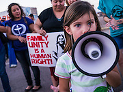 "23 JUNE 2012 - PHOENIX, AZ: A girl leads chants against Maricopa County Sheriff Joe Arpaio in front of the jail Saturday. About 2,000 members of the Unitarian Universalist Church, in Phoenix for their national convention, picketed the entrances to the Maricopa County Jail and ""Tent City"" Saturday night. They were opposed to the treatment of prisoners in the jail, many of whom are not convicted and are awaiting trial, and Maricopa County Sheriff Joe Arpaio's stand on illegal immigration. The protesters carried candles and sang hymns.       PHOTO BY JACK KURTZ"