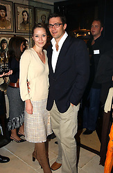 BROOKE JOHNSTON and ANDREW WESSELS at a party to celebrate the launch of the Katharine Pooley interiors store, 160 Walton Street, London SW3 on 20th October 2004.<br />