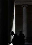 Visitors walk through a curtain of light splashing through the columns at the Legion of Honor museum courtyard in San Francisco, CA. Located in Lincoln Park overlooking the Golden Gate Bridge, the building is dedicated to the 3600 California soldiers who died in World War I.