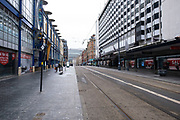 As the third national coronavirus lockdown continues, some people are still out and about but the streets remain eerily empty, like here on Corporation Street on 18th January 2021 in Birmingham, United Kingdom. Following the recent surge in cases including the new variant of Covid-19, this nationwide lockdown, which is an effective Tier Five, advises all citizens to follow the message to stay at home, protect the NHS and save lives.