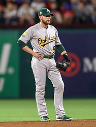 April 23, 2018 - Arlington, TX, U.S. - ARLINGTON, TX - APRIL 23: Oakland Athletics second baseman Jed Lowie gets ready for a play during the game between the Texas Rangers and the Oakland Athletics on April 23, 2018 at Globe Life Park in Arlington, Texas. (Photo by Steve Nurenberg/Icon Sportswire) (Credit Image: © Steve Nurenberg/Icon SMI via ZUMA Press)