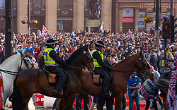 Glasgow, Scotland, UK. 15 May 2021. Thousands of supporters and fans of Rangers football club descend into George Square in Glasgow to celebrate winning the Scottish Premiership championship for the 55th time and the first time for 10 years. Pic; Police horse used to block access to the square. Iain Masterton/Alamy Live News