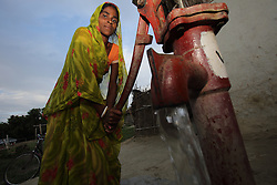 Phulo Ram draws water from a tubewell in Ganespur Community of Bastipur NEWAH WASH project Siraha, Udayapur District, Nepal.