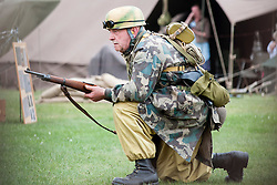 """Reenactor of the NWW2A Portraying a member of the """"Green Devils"""" during a battle reenactment at Fort Paull on Sunday ..5 May 2013.Image © Paul David Drabble"""