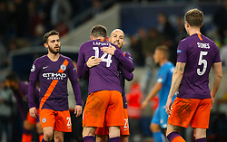Manchester City's Aymeric Laporte and Manchester City's David Silva celebrate after the final whistle