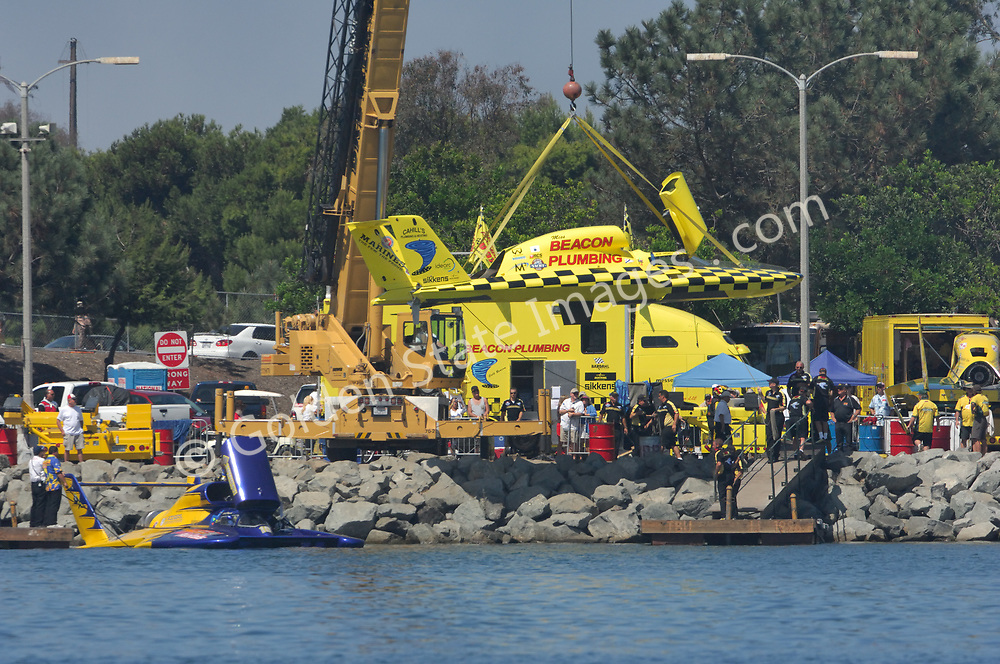 Unlimited Hydroplane Preparing for a Heat Race.  A crane lifts a Thunderboat into the water prior to a heat race.
