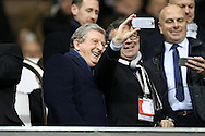 Roy Hodgson, the England manager takes a selfie with one of the guests before k/o. UEFA Europa League round of 16, 2nd leg match, Tottenham Hotspur v Borussia Dortmund at White Hart Lane in London on Thursday 17th March 2016<br /> pic by John Patrick Fletcher, Andrew Orchard sports photography.
