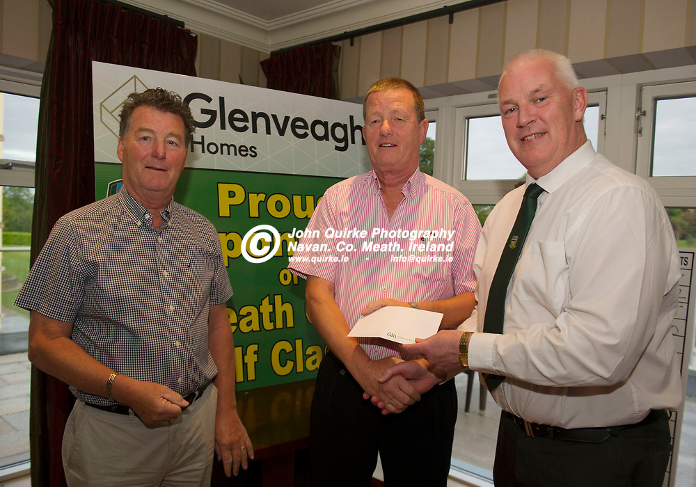 21-06-19. Meath GAA Annual Golf Classic 2019 at Knightsbrook Hotel and Golf Resort, Trim. Co. Meath.<br /> John Kavanagh (Right), Vice Chairman, Meath GAA pictured presenting 2nd. Prize to Sean Dempsey and Brendan Dempsey, Dempsey Insurance.<br /> Photo: John Quirke / www.quirke.ie<br /> ©John Quirke Photography, Unit 17, Blackcastle Shopping Cte. Navan. Co. Meath. 046-9079044 / 087-2579454.