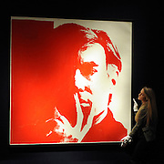 London News pictures. 08.02.2011. A woman holds a rediscovered self-portrait by Andy Warhol. The picture painted in 1967 which has been in a private collection since 1974 is expected to realise 3 million to 5 million pounds. A preview, today (Fri) of Christie's Auction House Post-War and Contemporary Art Evening Auction. The sale is expected to make a combined total of 46,246,000 to 66,447,000 when it is sold on 16th Feb 2011.. Picture Credit should read Stephen Simpson/LNP