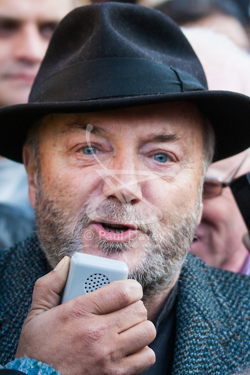 London February 15th 2015. British Pakistanis demonstrate outside Downing Street against Altaf Hussain a Pakistani politician living in exile as a naturalised citizen in the United Kingdom. The Muttahida Qaumi Movement (MQM) leader  is accused of masterminding dozens of politically motivated murders in Pakistan.PICTURED:  George Galloway MP addresses the protest.    //Contact/payment details tel 07966016296 paul@pauldaveycreative.co.uk