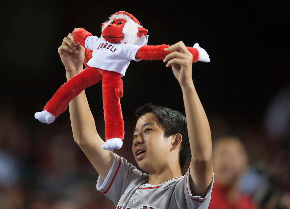 An Angel fan cheers on the team during their 4-2 victory over Kansas City Wednesday night at Angel Stadium.<br /> <br /> ///ADDITIONAL INFO:   <br /> <br /> angels.0428.kjs  ---  Photo by KEVIN SULLIVAN / Orange County Register  --  4/27/16<br /> <br /> The Los Angeles Angels take on the Kansas City Royals Wednesday at Angel Stadium.<br /> <br /> <br />  4/27/16