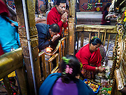 07 MARCH 2017 - KATHMANDU, NEPAL: A man presents offerings to a volunteer at the Kamaladi Ganesh Temple, the most important Hindu temple dedicated to Ganesh, known as the overcomer of obstacles, in Kathmandu. In Hindu theology, Tuesdays are the best day to pray to Ganesh and the temple is very busy on Tuesdays. People frequently visit temples dedicated to Ganesh when they buy a new home or start a new job.     PHOTO BY JACK KURTZ