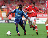 Shaun Wright-Phillips (Man City) and Mark Kinsella (Charlton). Charlton Athletic v Manchester City. FA Premiership, 19/8/00. Credit: Colorsport / Andrew Cowie.
