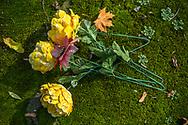 Artificial flowers on a grave at Rakowicki cemetery in Krakow, Poland 2019.