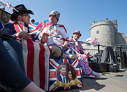 © Licensed to London News Pictures. 15/05/2018. Windsor, UK. Royal fans, who are the first to camp out on the procession route in Windsor High Street, enjoy the afternoon sunshine ahead of the marriage of Prince Harry and Meghan Markle on Saturday. Photo credit: Peter Macdiarmid/LNP