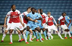 Coventry City's Jordy Hiwula grapples with Arsenal's Julio Pleguezuelo