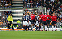 Fotball<br /> Foto: SBI/Digitalsport<br /> NORWAY ONLY<br /> <br /> Skottland v Norge<br /> 09.10.2004<br /> <br /> Scotland's James McFadden (10) is shown the red card for deliberately handling the ball on the goal-line.