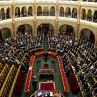 Janos Ader (C) takes the oath of office as President of Hungary in the presence of the parliamentary majority with the Socialist fraction (L) protesting leaving their seats empty in Budapest, Hungary on May 02, 2012. ATTILA VOLGYI