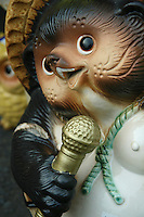 Tanuki is the Japanese word for a raccoon.  These creatures have been represented in Japanese folklore for hundreds of years.  The tanuki have a reputation for being mischievous.  At the same time they are jolly, good at disguising themselves. They are also absent-minded. and gullible according to legend.