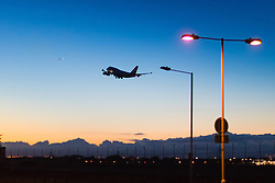 A British Airways Boeing 747-400 departs London Heathrow's runway 27L following sunset.