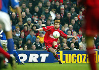 Fotball: Liverpool John Arne Riise take a free-kick in front of a Lucazade Sport advertising board against Birmingham City during the FA Cup 3rd Round match at Anfield. Liverpool won 3-0. Saturday 5th January 2002.<br /><br />Foto: David Rawcliffe, Digitalsport