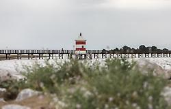 THEMENBILD - der Leuchtturm Faro Rosso ist eine historische Sehenswürdigkeit und steht am Ende eines 200 m langen Steges. Man blickt von dort in die Lagune. Lignano ist ein beliebter  Badeort an der italienischen Adria-Küste, aufgenommen am 15. Juni 2019, Lignano, Italien // the lighthouse Faro Rosso is a historical sight and stands at the end of a 200 m long footbridge. Lignano is a popular seaside resort on the Italian Adriatic coast on 2019/06/15, Lignano Sabbiadoro, Italy. EXPA Pictures © 2019, PhotoCredit: EXPA/ Stefanie Oberhauser