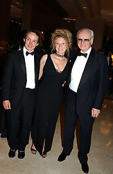 Left to right, MR & MRS WALTER SWINBURN and SIR PETER O'SULLEVAN  at the 2004 Cartier Racing Awards in association with the Daily Telegraph, held at the Four Seasons Hotel, London on 17th November 2004.<br />