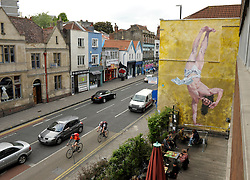 © Licensed to London News Pictures. 11/06/2013. Bristol, UK.  A mural titled Jesus Breakdancing by artist Cosmo Sarson on the wall by The Canteen bar on Stokes Croft in Bristol.  Cosmo won a competition sponsored by The Canteen to paint the mural, which was made with 1kg of gold glitter.  The mural was inspired by a breakdancing performance at the Vatican for Pope John Paul II.  11 June 2013.<br />