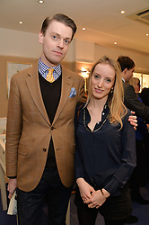 MARTIN WILLIAMS and HARRIET ARBUTHNOT at a preview of the latest collections by jewellery designer Kiki Mcdonough and fashion label Beulah held at Kiki McDonough Jewellery, 12 Symons Street, London on 5th March 2014.