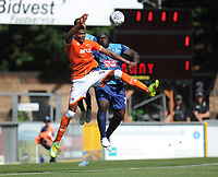 Blackpool's Michael Nottingham vies for possession with Wycombe Wanderers' Adebayo Akinfenwa<br /> <br /> Photographer Kevin Barnes/CameraSport<br /> <br /> The EFL Sky Bet League One - Wycombe Wanderers v Blackpool - Saturday 4th August 2018 - Adams Park - Wycombe<br /> <br /> World Copyright © 2018 CameraSport. All rights reserved. 43 Linden Ave. Countesthorpe. Leicester. England. LE8 5PG - Tel: +44 (0) 116 277 4147 - admin@camerasport.com - www.camerasport.com