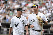 CHICAGO - JULY 27:  John Danks #50 talks with Adam Dunn #32 of the Chicago White Sox during the game against the Detroit Tigers on July 27, 2011 at U.S. Cellular Field in Chicago, Illinois.  The White Sox defeated the Tigers 2-1.  (Photo by Ron Vesely)  Subject: John Danks;Adam Dunn