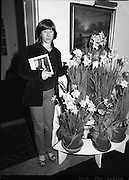 Galway Travellers Visit U.S.Embassy.    (N67)..1981..01.04.1981..04.01.1981..1st April 1981..Elizabeth,the wife of American Ambassador Mr William Shannon,invited a group of Galway travellers to afternoon tea at the residence in Phoenix Park, Dublin...This Galway youngster is pictured with her commemorative book as she poses beside seasonal daffodils.