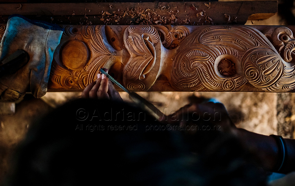 Kauri (Tekaurinui Robert) Parata, carve traditional Maōri designs at his home in Whangārei. Kauri is a member of the Manu Taupunga group that is the organising arm of the whale-body recovery operation started by his father, Hori Parata.From a story on whale strandings for The Guardian media group.