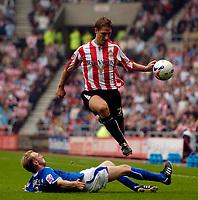 Photo: Jed Wee.<br />Sunderland v Leicester City. Coca Cola Championship. 16/09/2006.<br /><br />Sunderland's Robbie Elliott hurdles over a challenge from Leicester's Stephen Hughes.