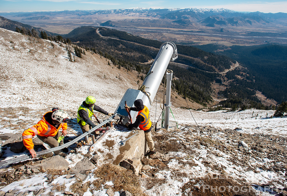Wade Whiddon of the ground engineering company Geovert, Brandon Dodge of Gazex and John Fitzgerald with the Wyoming Department of Transportation work on installing one of two new Gazex exploder tubes Friday in Glory Bowl on Teton Pass. The new exploders complete an upgrade of the original Gazex tubes used for avalanche mitigation on Mt. Glory. A third exploder in Glory Bowl and the single tube in Twin Slide were replaced in 2015. Go to jhnewsandguide.com for a video of the helicopter installation of one of the tubes.