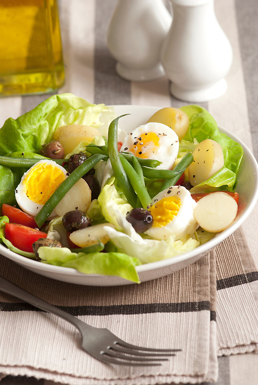 Boiled egg, green bean and lettuce salad in a bowl