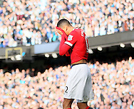 Chris Smalling of Manchester United hides his face following his red card - Barclays Premier League - Manchester City vs Manchester Utd - Etihad Stadium - Manchester - England - 2nd November 2014  - Picture David Klein/Sportimage