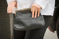 24/06/2019. London, UK. Handbag carried by Zamira Hajiyeva as she arrives at Westminster Magistrates Court in London for an extradition hearing on moves to extradite her to Azerbaijan, where she is wanted on two charges of embezzlement. Hajiyeva was the subject of the UK's first unexplained wealth order (UWO) after spending £16m in Harrods department store. Photo credit: Vickie Flores/LNP