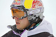 SHOT 12/18/10 10:54:28 AM - Simon Dumont of Bethel, Mainewatches a replay of his fall on his first run in the superpipe during the Supeprpipe Finals at the Nike 6.0 Open stop of the Winter Dew Tour at Breckenridge Ski Resort in Breckenridge, Co. Dumont would go on to win the event with a score of 94.50 on a stellar second run. The event features ski and snowboard slopestyle and superpipe. (Photo by Marc Piscotty / © 2010)