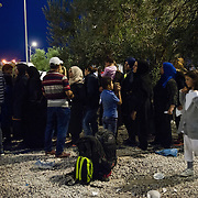 Syrian refugees queuing to be registered and receive a temporary document that allows them to travel to mainland Greece at Kara Tepe camp in Lesvos, Greece