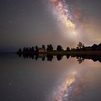 Astronomy photography image of the milky way reflection over the Salt Pond Bay located along the Cape Cod National Seashore at the Salt Pond Visitor Center in Eastham, Massachusetts.<br /> <br /> Cape Cod Salt Pond Bay Milky Way reflection photography images are available as museum quality photography prints, canvas prints, acrylic prints, wood prints or metal prints. Fine art prints may be framed and matted to the individual liking and decorating needs:<br /> <br /> https://juergen-roth.pixels.com/featured/milky-way-reflection-juergen-roth.html<br /> <br /> Good light and happy photo making!<br /> <br /> My best,<br /> <br /> Juergen
