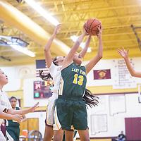Thoreau Hawk Leah Delgarito (13) and Tohatchi Cougar Krystal Benally (3) reach for a rebound Tuesday night at Tohatchi High School in Tohatchi. Tohatchi beat Thoreau 51-46.