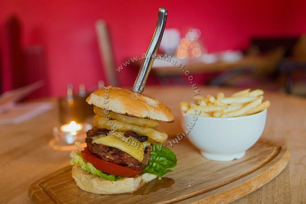 A burger is being served at The Durham Ox restaurant, in Crayke, Yorkshire, England, United Kingdom.