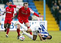 Photo: Chris Ratcliffe.<br />Colchester United v Swindon Town. Coca Cola League 1. 18/03/2006.<br />Chris Iwelumo (R) of Colchester tussles with Steve Jenkins of Swindon