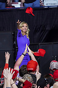 White House Press Secretary Kayleigh McEnany throws MAGA hats to the audience at the Keep America Great Rally in the North Charleston Coliseum February 28 2020 in North Charleston, South Carolina.
